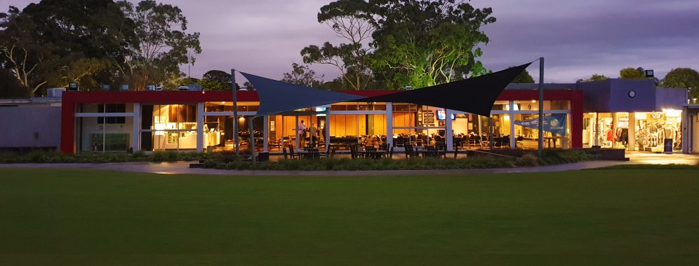 Clubhouse at night from course